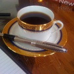Gold Rimmed Coffee Cup and Saucer with Montblanc Fountain Pen