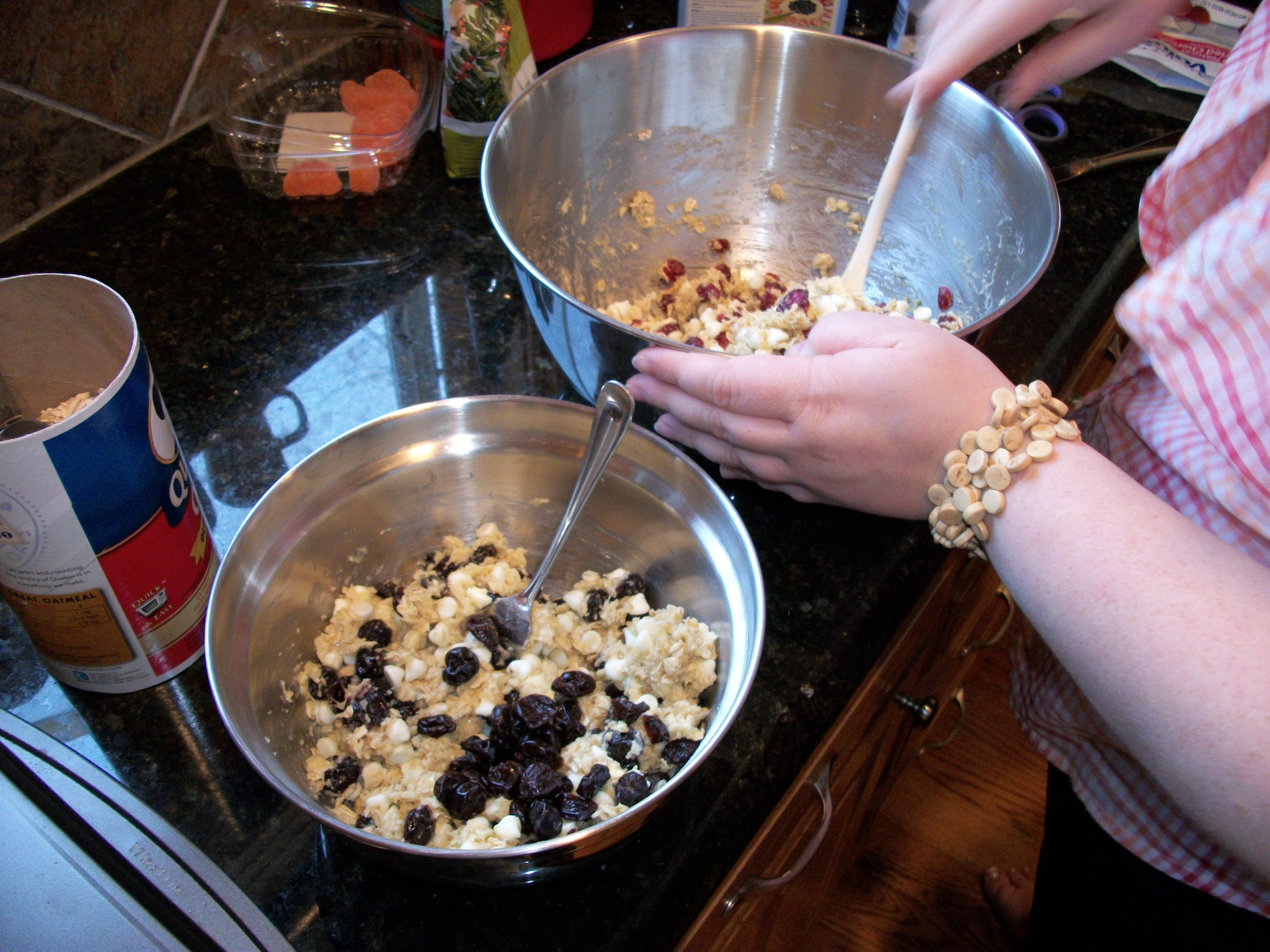 Jocelyn mixing the white chocolate oatmeal cookies with cranberries and cherries