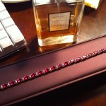 Diamond and Ruby Bracelet with Bottle of Coco Chanel Mademoiselle Perfume