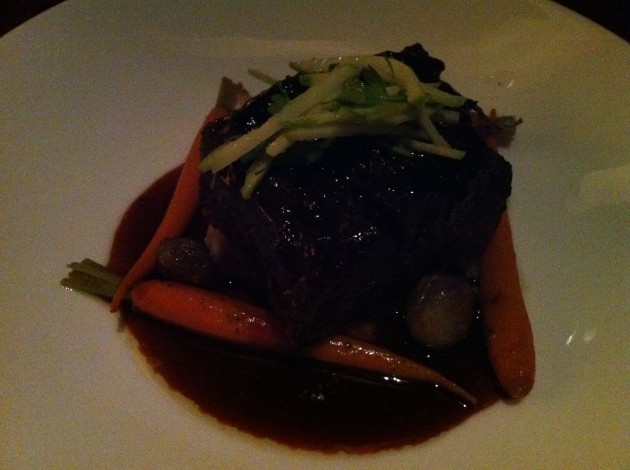 Jiko Braised Beef Short Rib with Truffled Potato Puree, Pearl Onions, Baby Carrots, and Cabernet-Tamarind Sauce