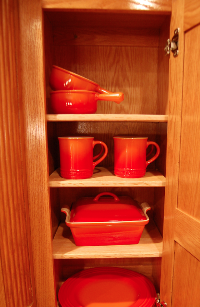 Le Creuset Flame Organized In Cabinet