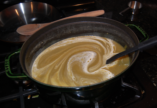 Stirring in a Few Tablespoons of Cream Into the Leek and Potato Soup