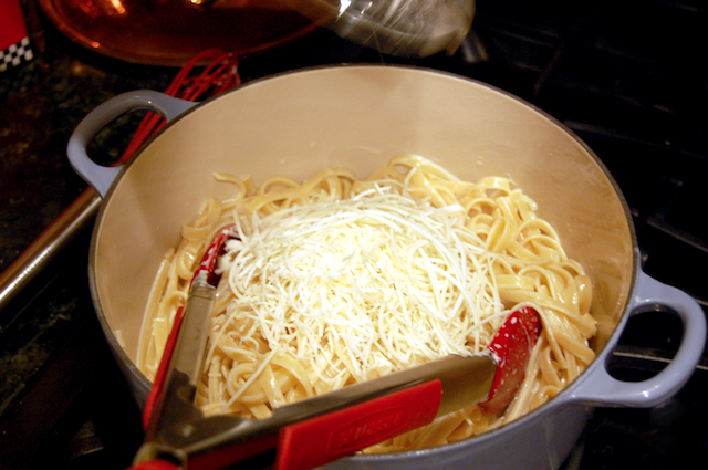 Adding Romano Cheese to the Alfredo Sauce
