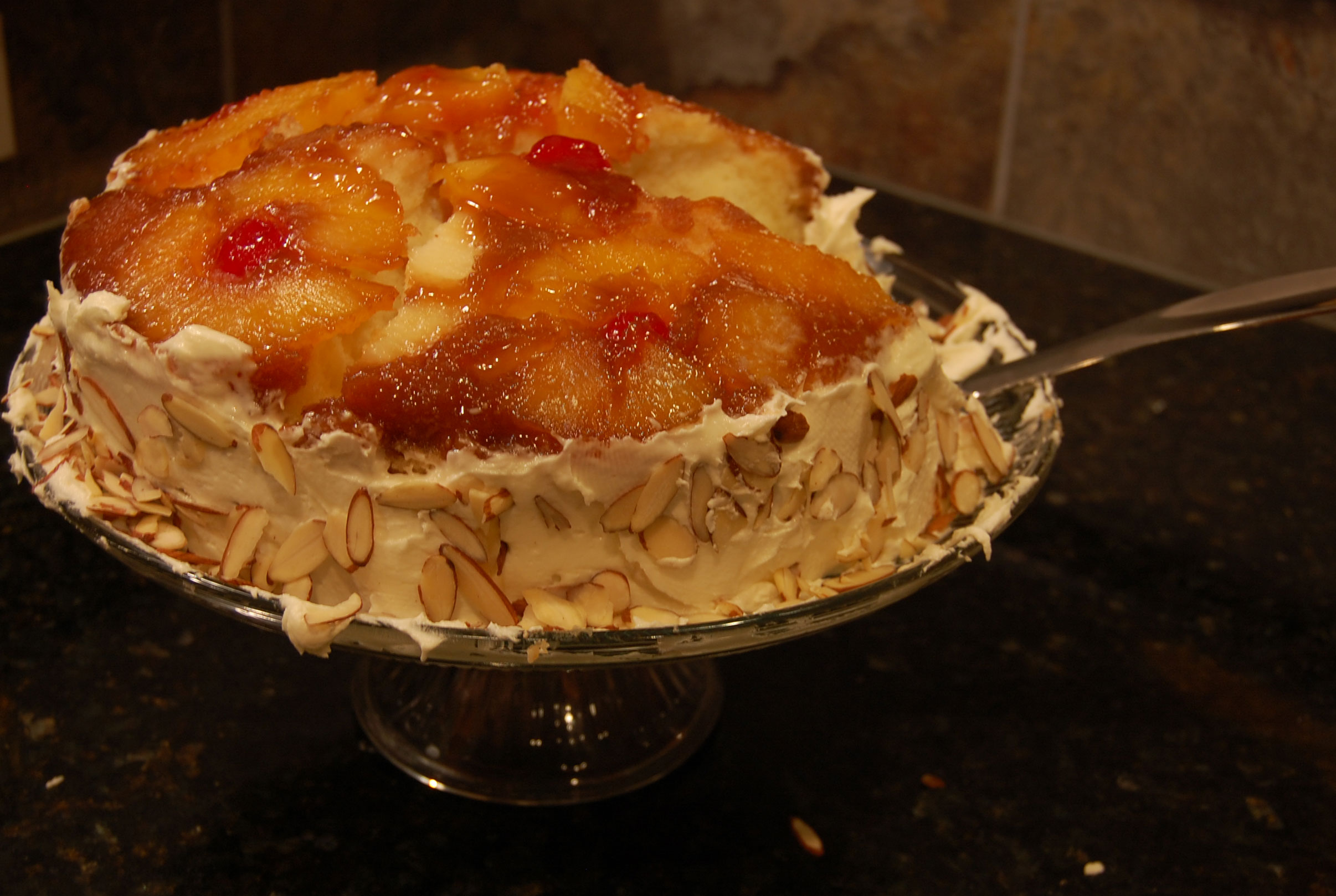 Frosted Almond Pineapple Upside Down Cake Stacked