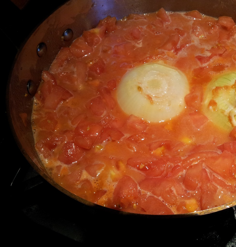 Putting the Ingredients for Butter Onion and Tomato Sauce Into Copper Pot