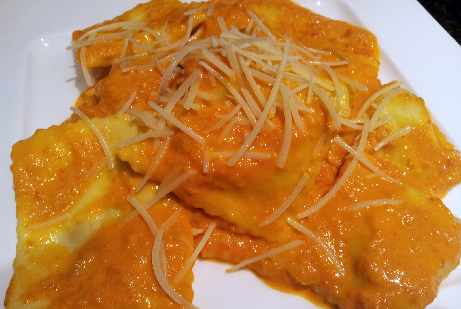 Tomato and Cream Sauce Over Stuffed Ravioli