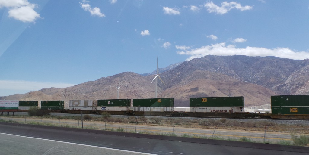Double Stacked Trains and Windmills Driving Into Palm Springs