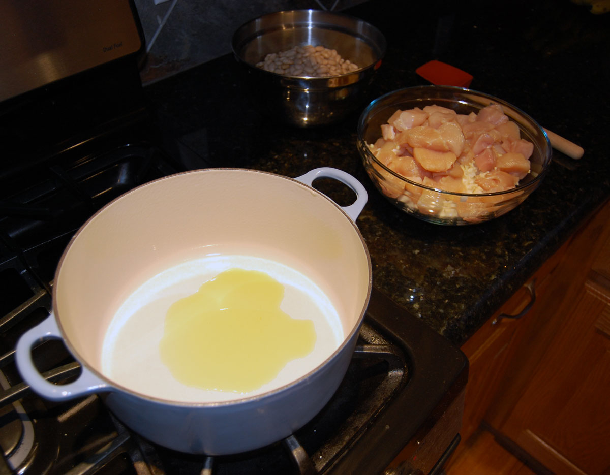 Heating Oil to Begin Cooking White Chicken Chili Recipe