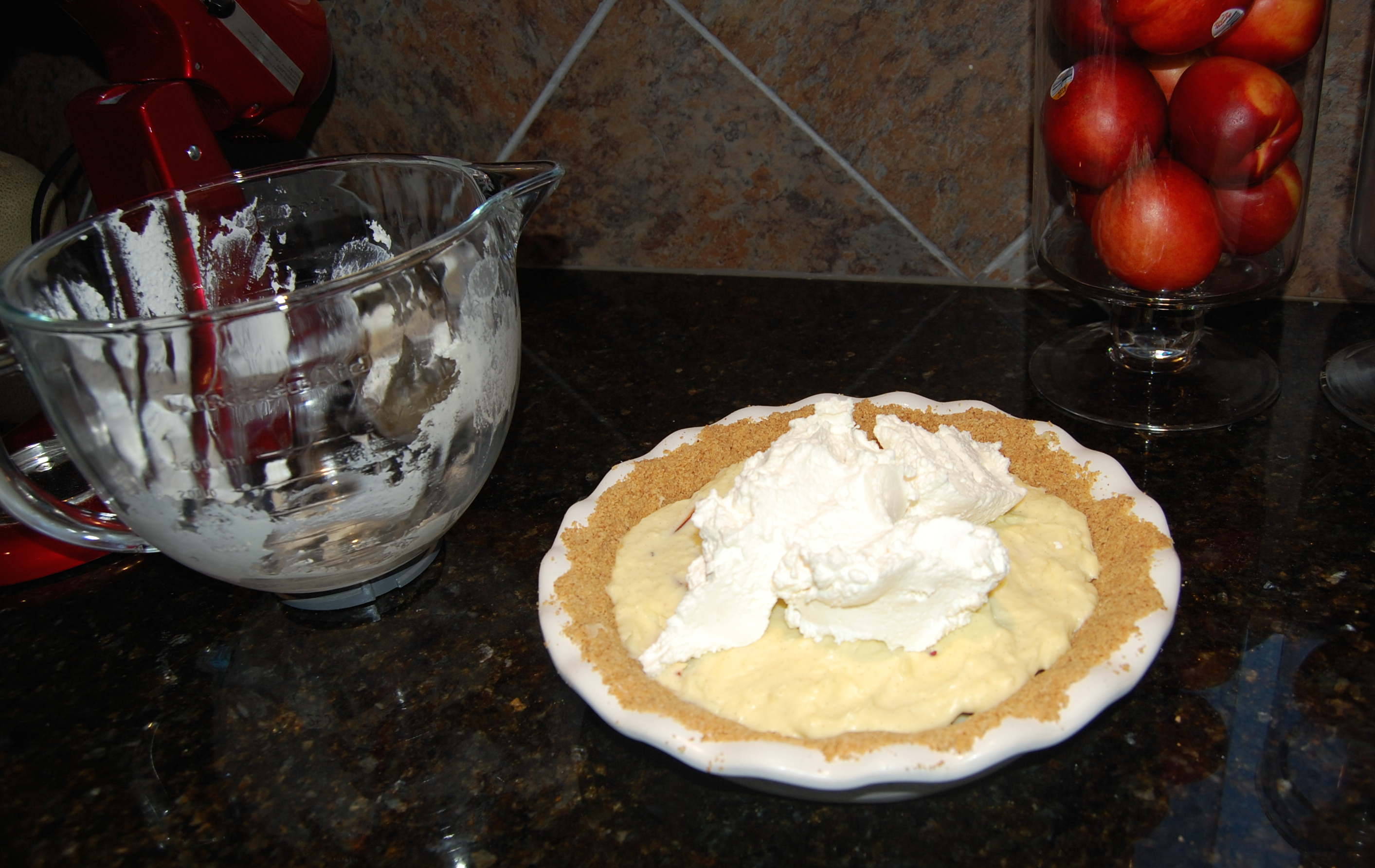 Spreading Whipped Cream on Nectarine White Chocolate Cream Pie