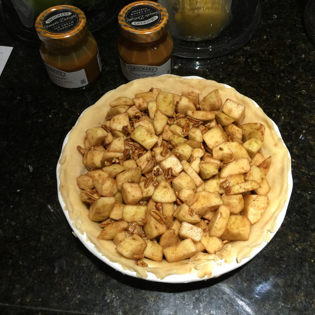 Filling in Caramel Apple Pie Crust Ready for Butter