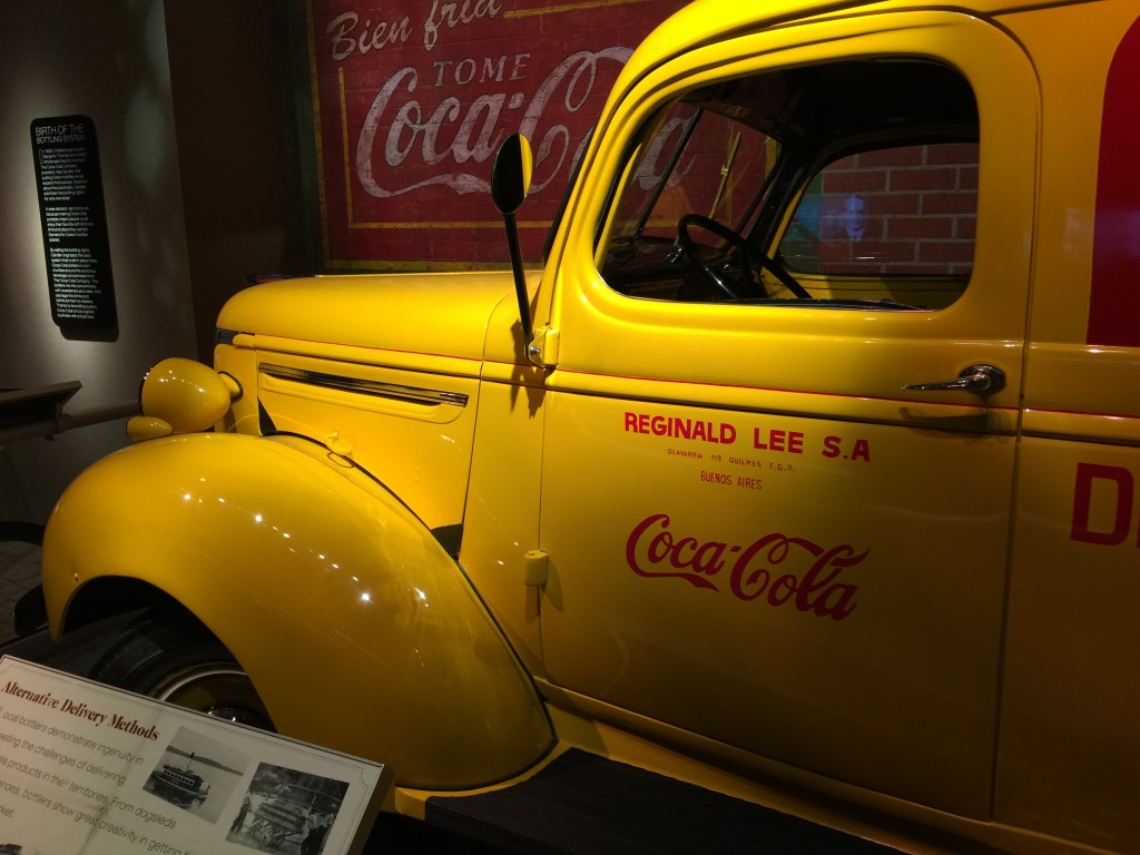 Yellow Coca-Cola Delivery Trucks