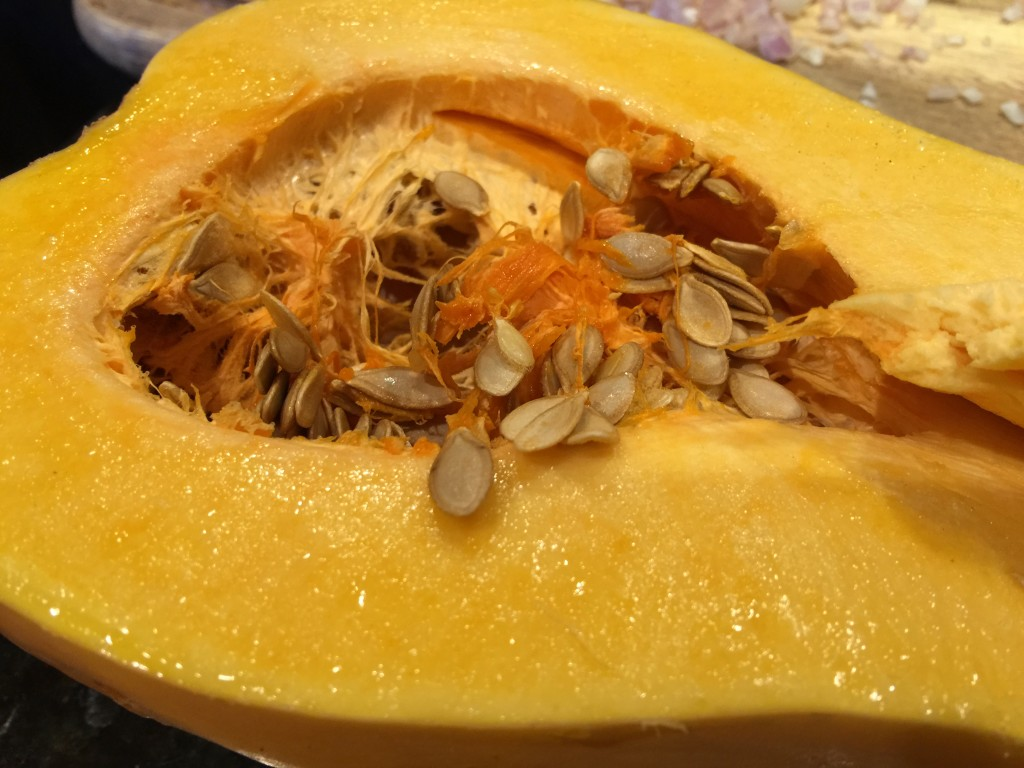Scoop Out Seeds and Fibers of Butternut Squash