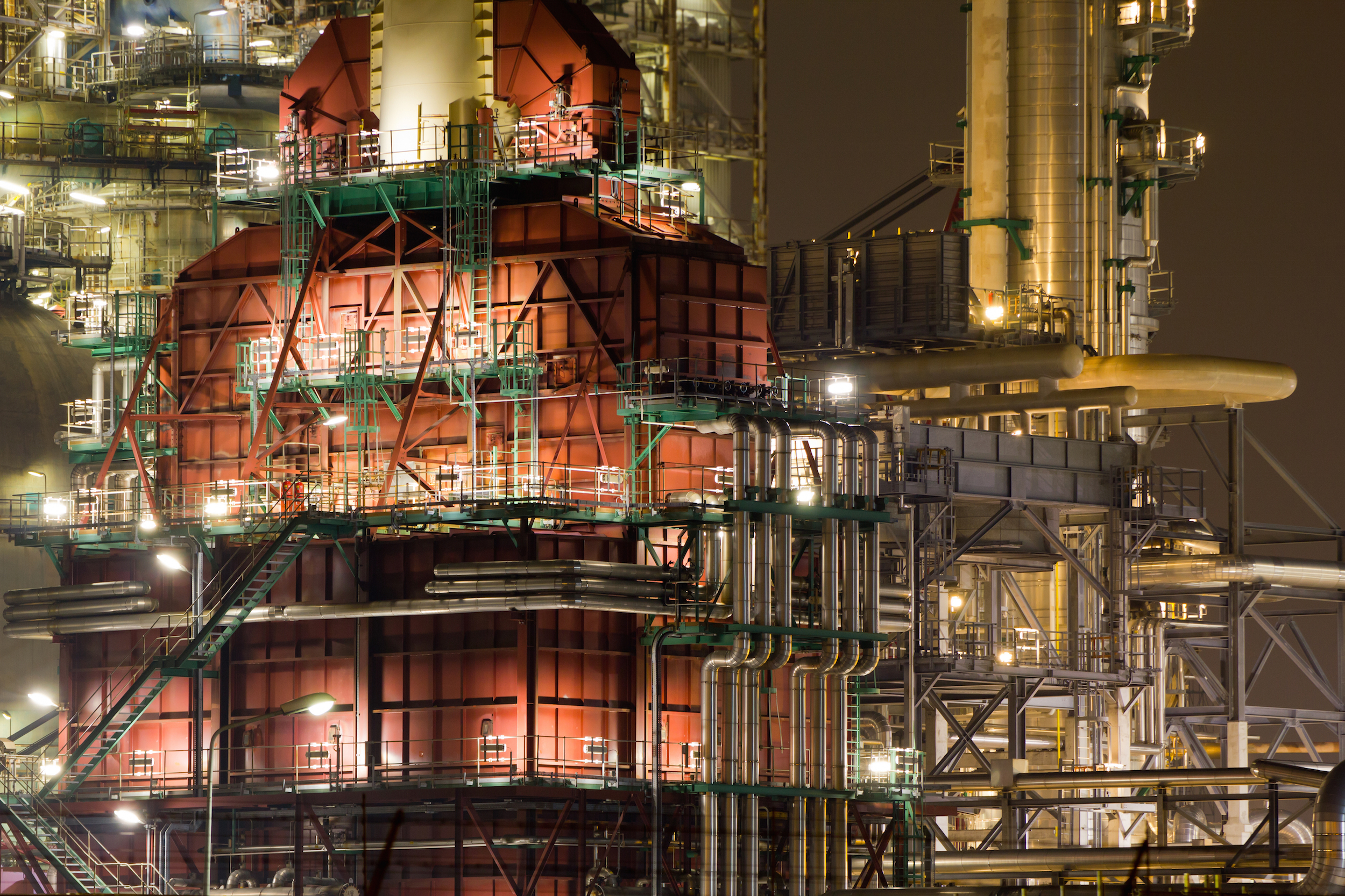 Red Coker Unit of Oil Refinery Plant at Night