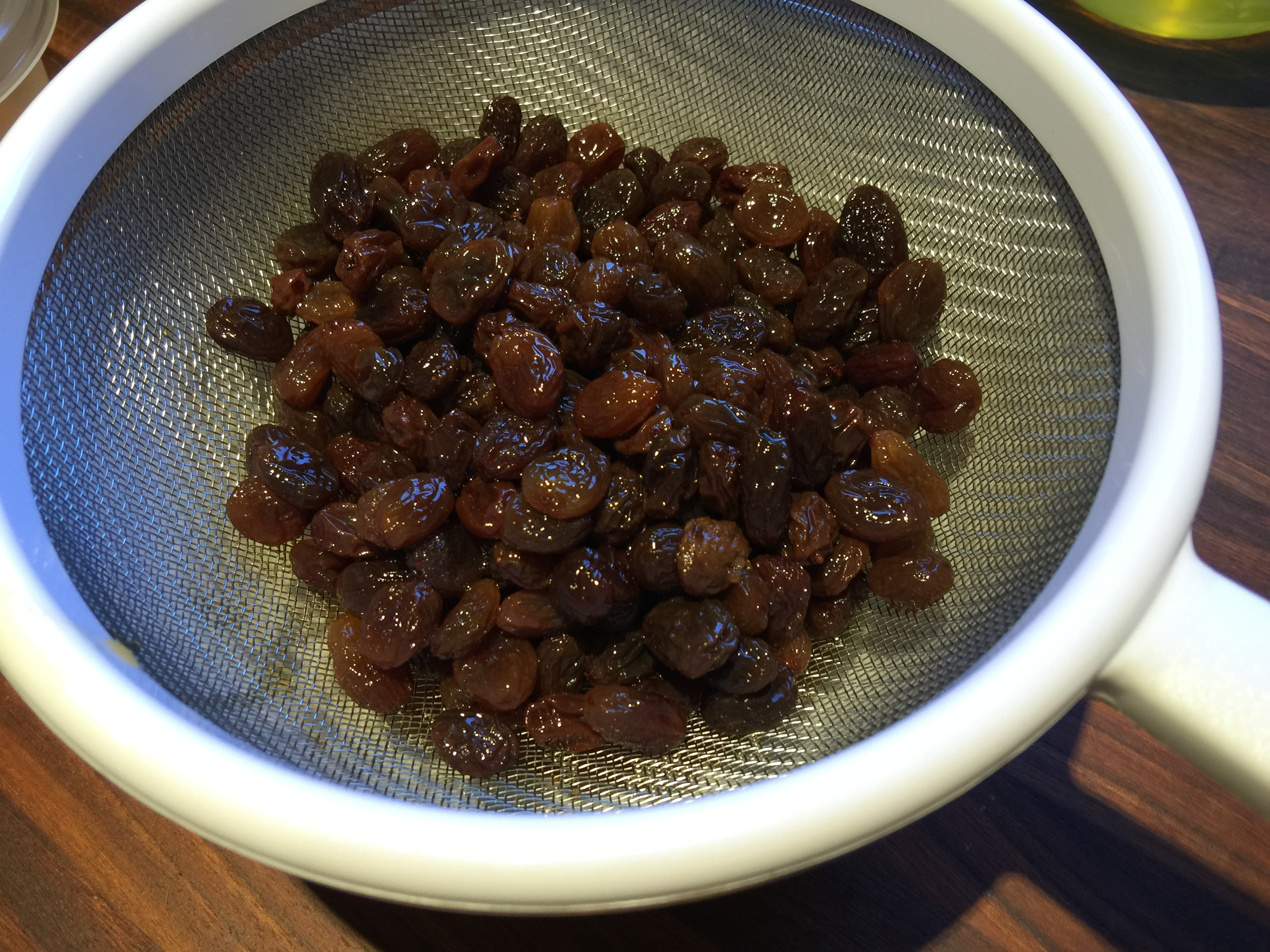 Straining Raisins and Rum for Ice Cream Recipe