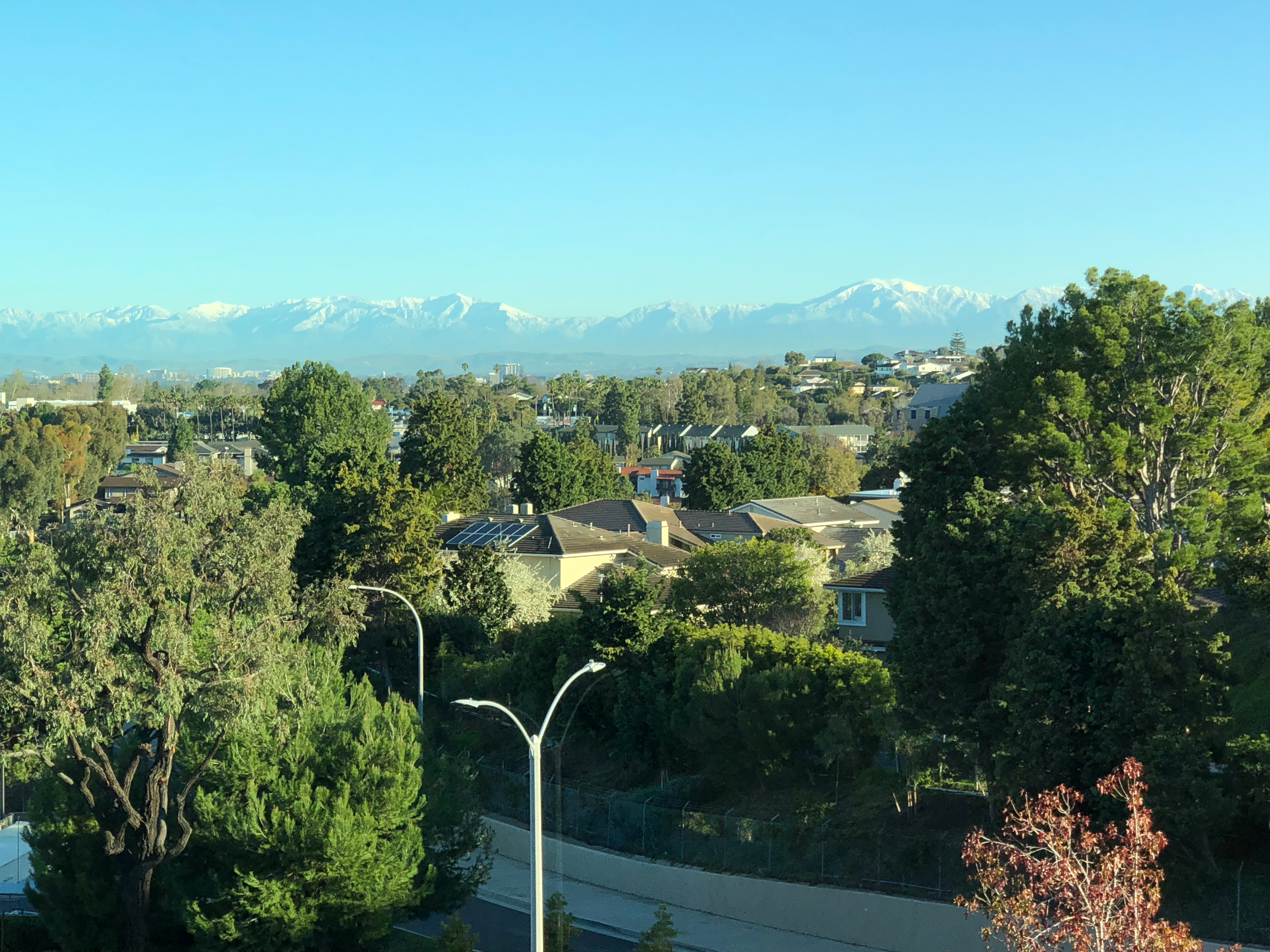 Snow on the Mountains in the Distance from Newport Beach