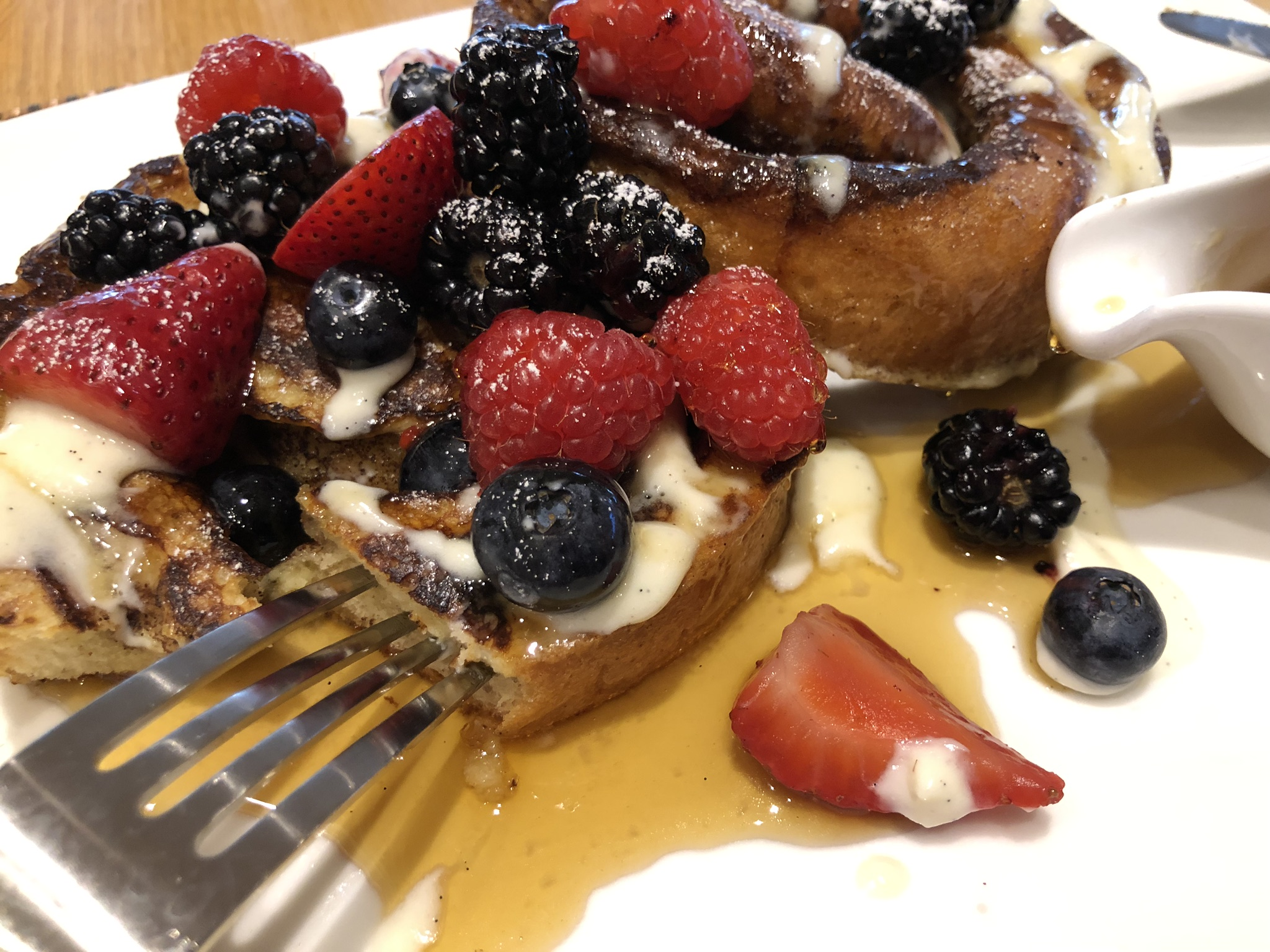 Oak Grill Newport Beach Cinnamon Roll French Toast with Fresh Berries After Syrup