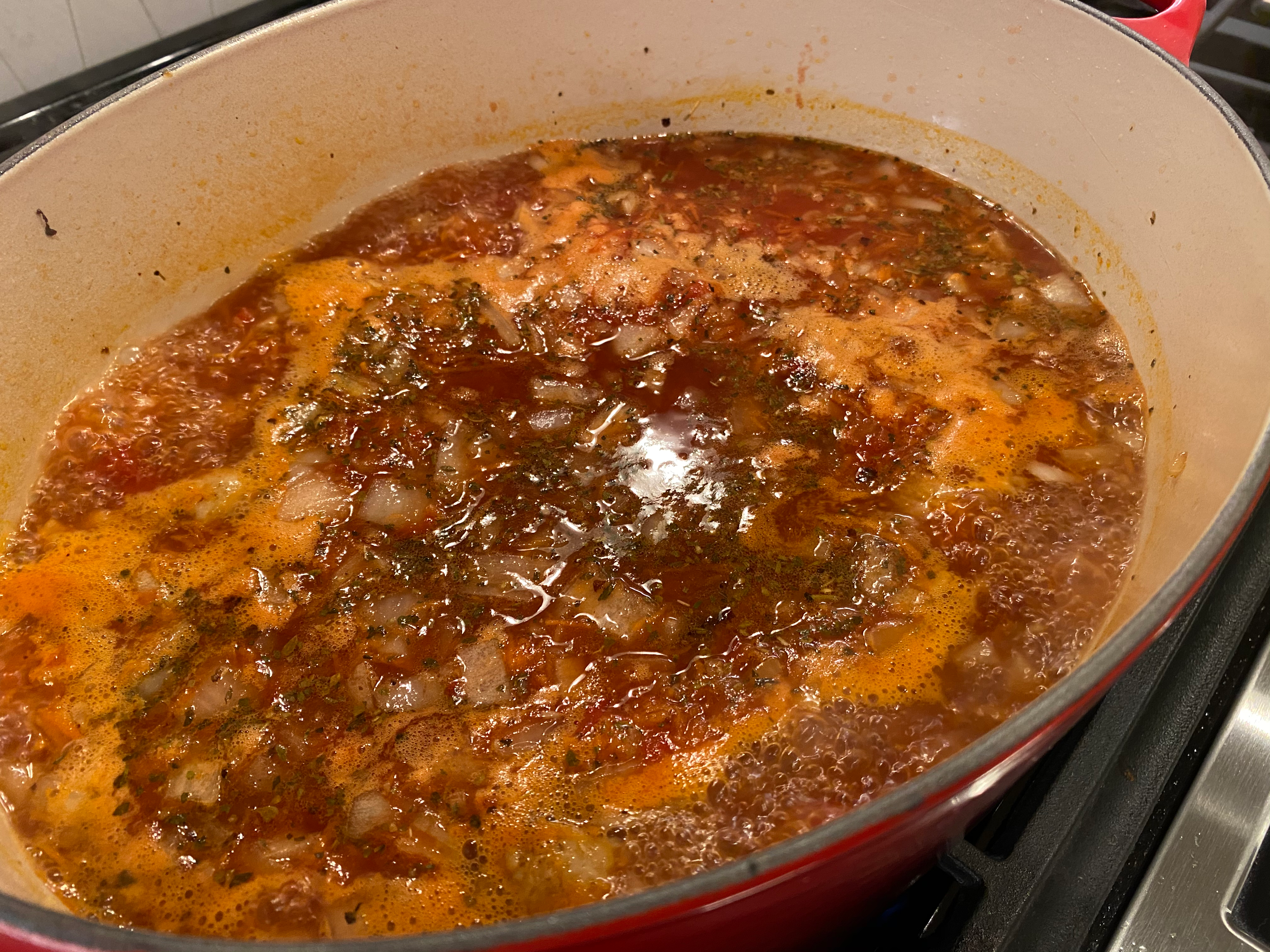 Adding the Soup Base Plus the Drained Italian Sausage then Letting Reduce